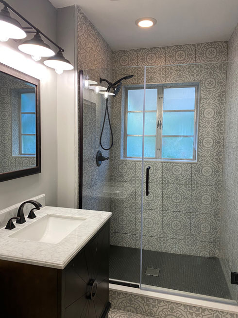 Bathroom Remodeling, modern bathroom with black accents and grey tiles